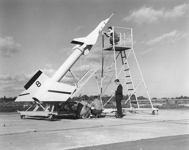 Avro technicians prepare an Avro Arrow test model attached to a Nike booster rocket to fire out over Lake Ontario at Point Petre in the 1950s.