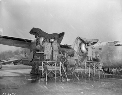 Through sleet and snow, Rockcliffe aircrew made sure the mail was delivered to the troops overseas, and back to families in Canada. Here they work on the engines of the mighty B24 at Rockcliffe.