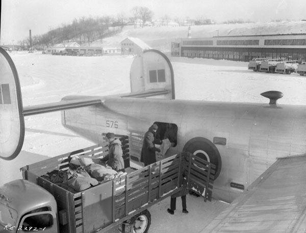 Mail trucks load the B24 with mailbags on a winter's day at Rockcliffe Airport 1944.