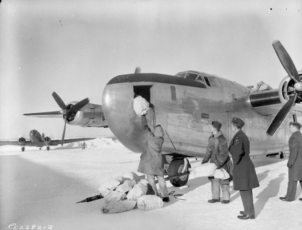 168 Squadron Rockcliffe aircrew load a B24 with mail on a cold Ottawa day.