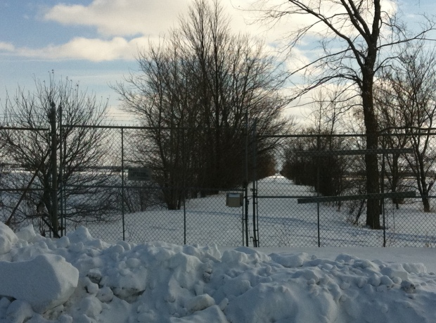 An abandoned road with a locked barbed wire encrusted gate sits north of Richmond, On.