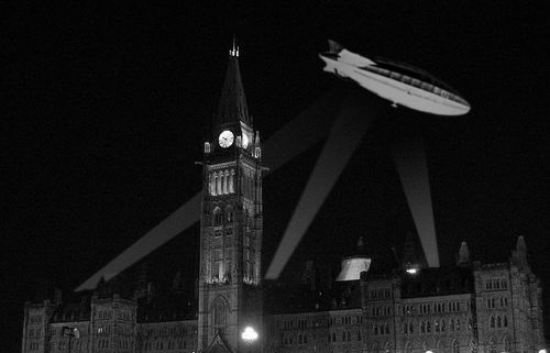 My artist's rendition of how the R100 may have looked hovering ob=ver the Parliament Buildings with searchlights on it as it passed over the city August 10 1930.