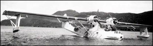 The amphibious PBY-Canso sitting in the water showing its large stature.