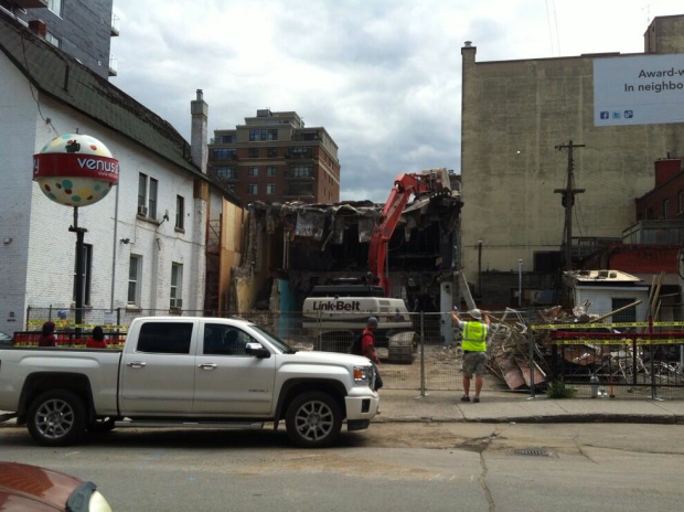 On July 4th the old Norge Village Laundromat and former Venus Envy store was demolished and the rare and iconic was lost with it. (photo via Twitter @venusenvyottawa)