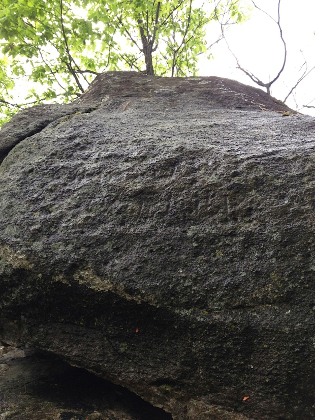 The inscription on the sone is obscured by lichen and is hardly legible.