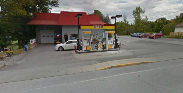 Bond then leaves Ottawa and drives to Frelighsburg, QC. Here he parks his car at a gas station. This is the gas station in Frelighsburgh as shown on Google streetview.