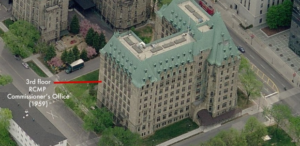 """The Headquarters of the Royal Canadian Mounted Police are in the Department of Justice alongside Parliament Buildings in Ottawa. Like most Canadian public buildings, the Department of Justice is a massive block of grey masonry built to look stodgily important and to withstand the long and hard winters."" -Bond"