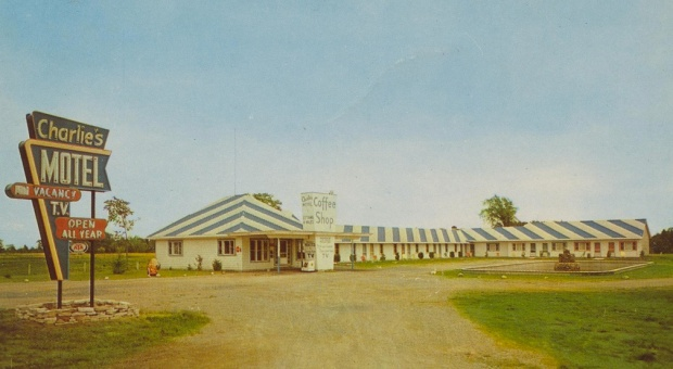 "A 1950s postcard showing ""Charlie's Motel"". Note the distinctive striped roof."