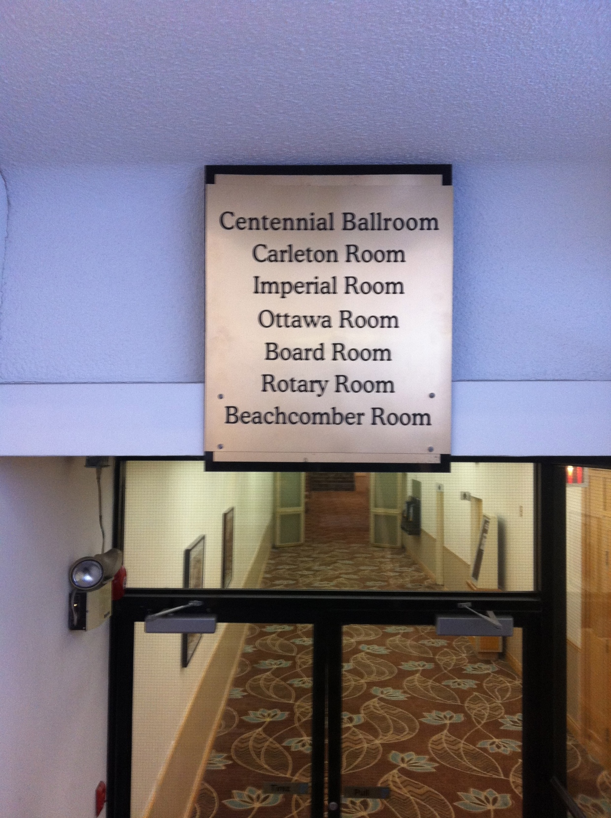 """A clue...marked on an old sign in the stairway is """"BEACHCOMBER ROOM"""""""