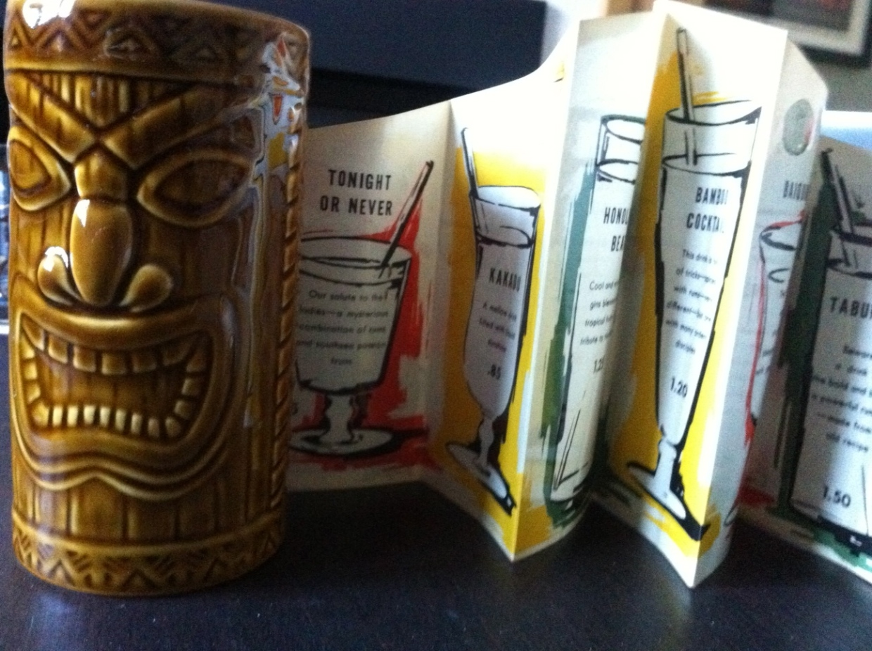 A tiki-mug and an original Ottawa Tiki-bar menu.