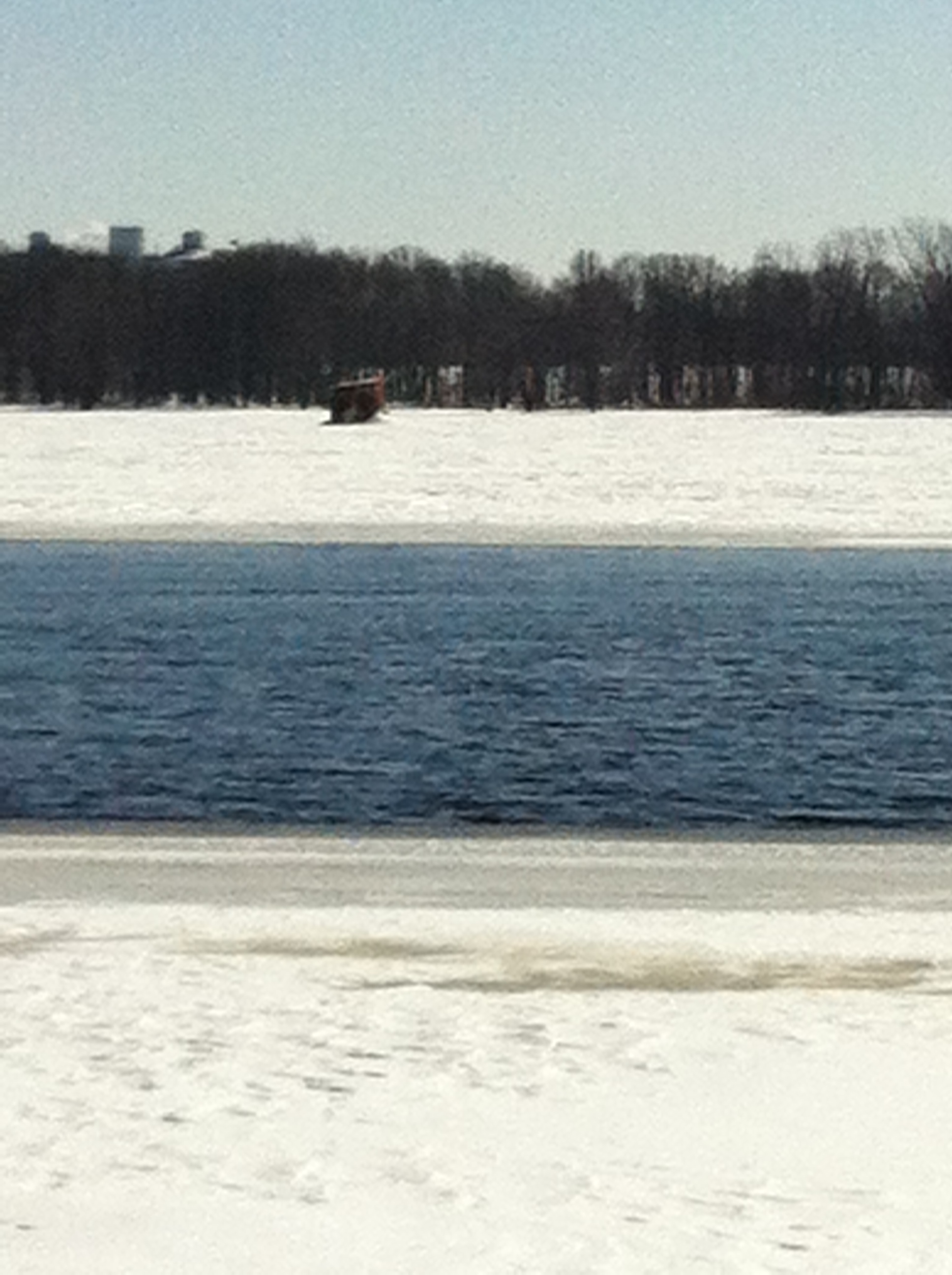 The beacon ruins, literally frozen in time, encased in ice on the Ottawa River. The neighbourhood of Beacon Hill, which got its name from this very lighthouse, is in the background.