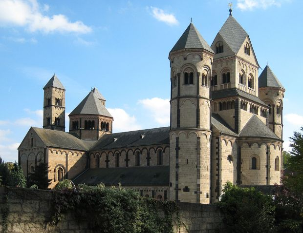 The Romanesque style featured on the church by the architect Edey  featured turrets and arches, like medieval European castles.