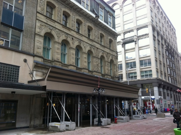 "Dubbed ""Canada's Four Corners Building"", the structure has been covered with scaffolding for years."