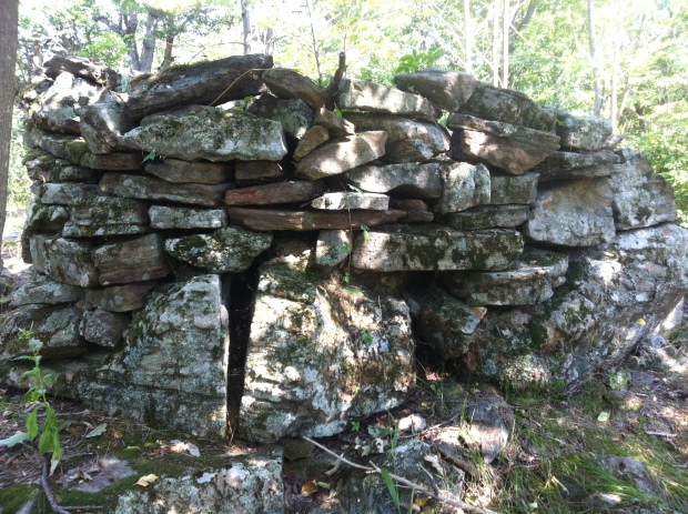 A mysterious stone structure stumbled upon in the woods high atop a geological formation.
