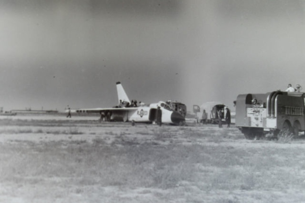 NEGATIVE 2 INVERSION: RL201 skidded off the runway after the landing gear collapsed.