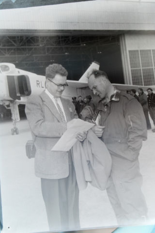 NEGATIVE 5 INVERSION: Arrow test pilot Zurakowski chatting with someone.