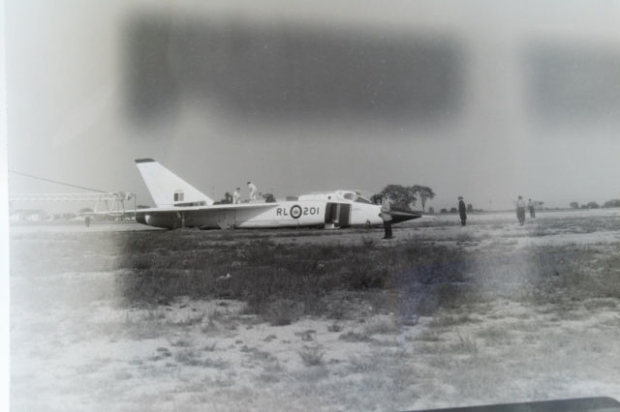NEGATIVE 6 INVERSION: The prototype Arrow RL 201with landing gear collapsed on the Malton runway, June 11th, 1958.