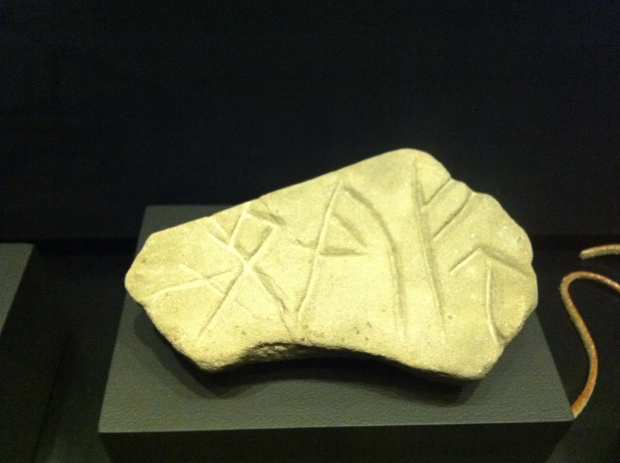 A stone with Viking rune carvings inscribed.