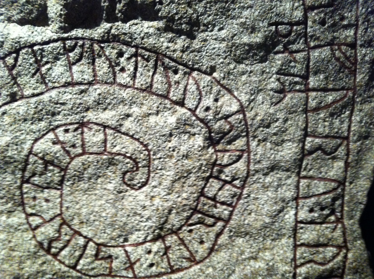 Viking rune stone inscribed with Norse writing.