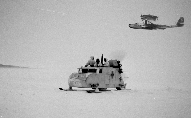German tracked snow vehicle on patrol for Indiana Jones with a Dornier seaplane above. (Note: fictional composite photo)
