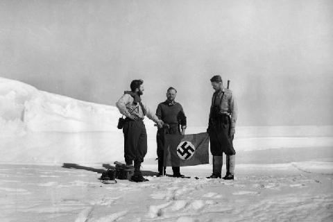 The Nazi flag being placed on Antarctica. 1939. (photo: WikiLeaks)
