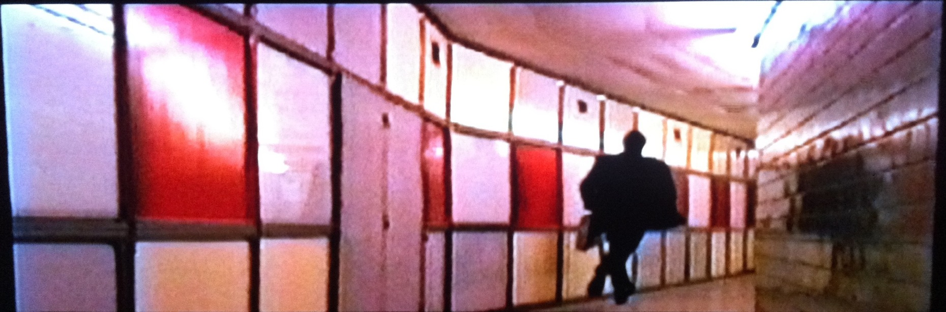 A still from the film that shows the coloured panels and storage area behind them.