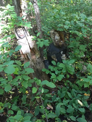 Creepy monk carvings in forest stumps off the trails...